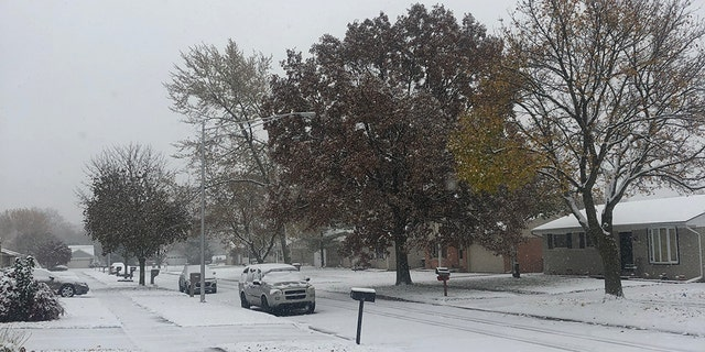Snow was accumulating in Taylor, Mich. on Monday morning as an arctic front was bringing wintry conditions to the Midwest.