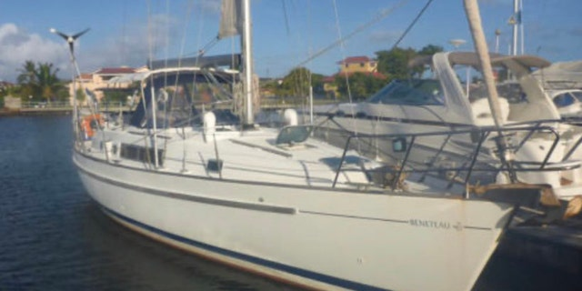 The Coast Guard had said three people were on board the 40-foot sailboat named Dove.