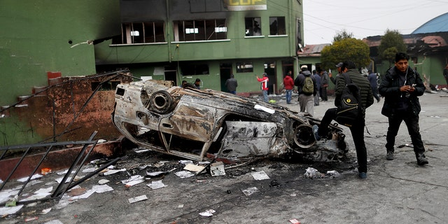 A police station was attacked by supporters of Morales in El Alto, on the outskirts of La Paz. (AP Photo/Natacha Pisarenko)