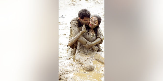 Westlake Legal Group mud-wedding-1-binu-seens-photography- Couple canoodles in mud for 'post wedding' photo shoot Janine Puhak fox-news/lifestyle/weddings fox-news/lifestyle/relationships fox-news/lifestyle fox news fnc/lifestyle fnc article aad17163-f636-5205-8fbd-f2d96db1ca6a
