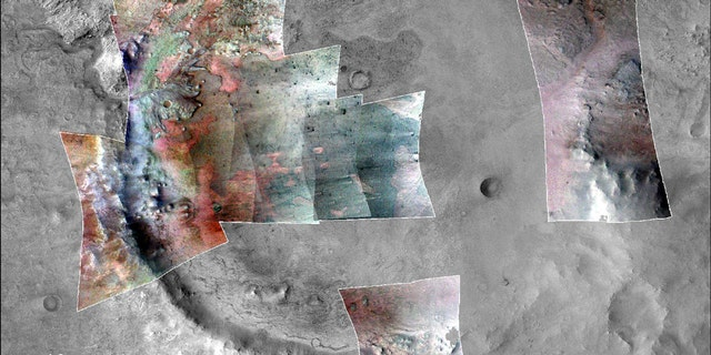 Color has been added to highlight minerals in this image of Jezero Crater on Mars, the landing site for NASA's Mars 2020 mission. The green color represents minerals called carbonates, which are especially good at preserving fossilized life on Earth. (Credit: NASA/JPL-Caltech/MSSS/JHU-APL/Purdue/USGS)