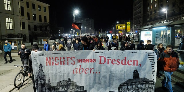15 February 2019, Saxony, Dresden: Neo-Nazi marchers in Dresden meet counter-protesters Photo: Str./dpa