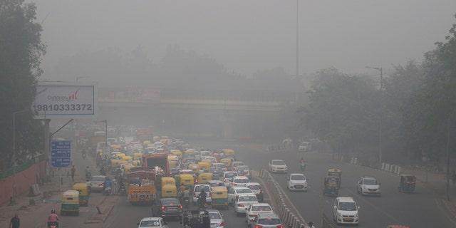 """Authorities in New Delhi are restricting the use of private vehicles on the roads under an """"odd-even"""" scheme based on license plates to control vehicular pollution. (AP Photo/Manish Swarup)"""