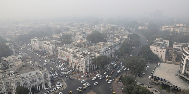 Delhi's skyline is seen enveloped in smog and dust in on Friday. (AP Photo/Manish Swarup)