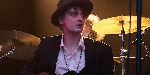 FILE - In this May 4, 2017 file photo, British musician Pete Doherty performs on stage during a concert in Paris. Paris authorities say Doherty has been arrested in Paris for buying drugs.