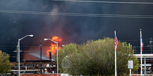 Smoke and fire are visible from the TPC Group Port Neches Operations explosion on Wednesday. (Marie D. De Jesus /Houston Chronicle via AP)