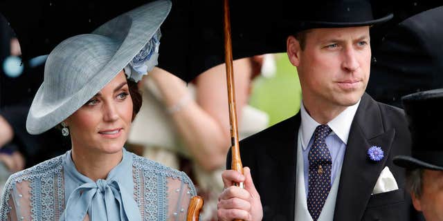 Catherine, Duchess of Cambridge and Prince William, Duke of Cambridge shelter under an umbrella as they attend day one of Royal Ascot at Ascot Racecourse on June 18, 2019, in Ascot, England. (Photo by Max Mumby/Indigo/Getty Images)