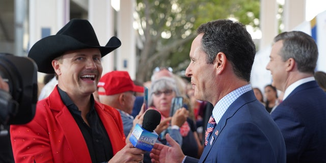 John Rich talks with Brian Kilmeade on the red carpet at Fox Nation's Patriot Awards in St. Petersburg, Fla.