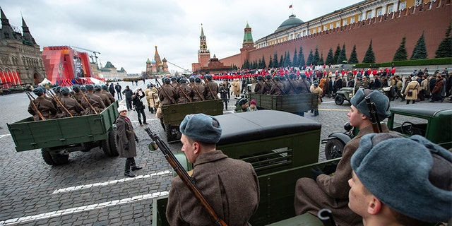 Russian soldiers dressed in Red Army World War II winter uniforms wait to take a part in a reconstruction of a World War II-era parade in Moscow's Red Square, Russia, on Thursday. (AP)