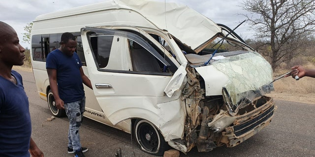 The giraffe was struck by a minibus and then sent careening into another vehicle.