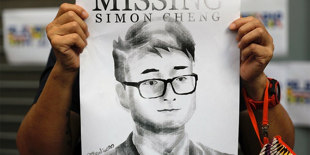 A believer of Simon Cheng binds a print outward of a British Consulate in Hong Kong in Aug during a convene in support of him. (AP)
