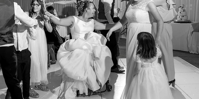 Emma Kitson dancing on her wedding day in her wheelchair.