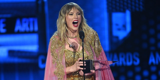 Taylor Swift accepts the award for artist of the decade at the American Music Awards on Sunday, Nov. 24, 2019, at the Microsoft Theater in Los Angeles