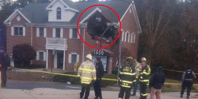 Two killed after Porsche becomes airborne and crashes into New Jersey building