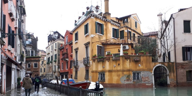 The historic squares of Venice were left deep underwater on Wednesday after most of the tourist mecca was inundated by the second-highest levels of flooding ever recorded.