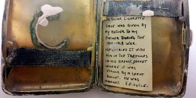A dented and damaged silver cigarette case, which appears to have taken the full force of bullet, has been unearthed by Hansons Auctioneers – and an aging note tucked inside reveals its secrets. (Credit: SWNS)