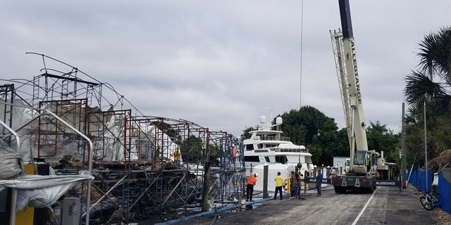 Aftermath of fire that destroyed two yachts worth $24 million in Fort Lauderdale Saturday.