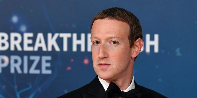 Facebook CEO Mark Zuckerberg arrives for a 8th annual Breakthrough Prize awards rite during NASA Ames Research Center in Mountain View, California on Nov 3, 2019.