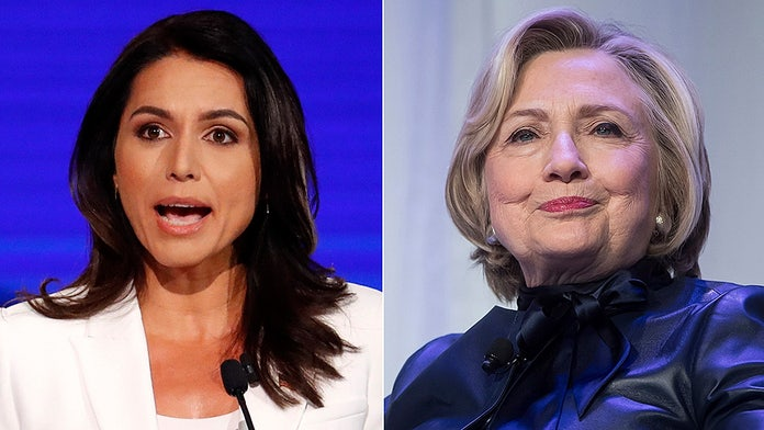 Image result for Gabbard sues Clinton for eye-popping sum over Russia claim""