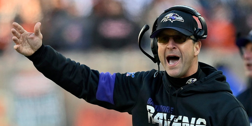 Harbaugh, Ravens happily travel road to success in playoffs