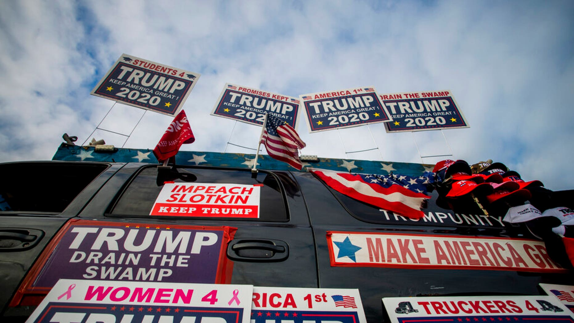 Trump supporters protest outside a town hall meeting where U.S. Rep. Elissa Slotkin (D-Mich.) is speaking on Monday, Dec. 16, 2019, in the Oakland Center at Oakland University in Rochester, Mich. (Jake May/The Flint Journal via AP)