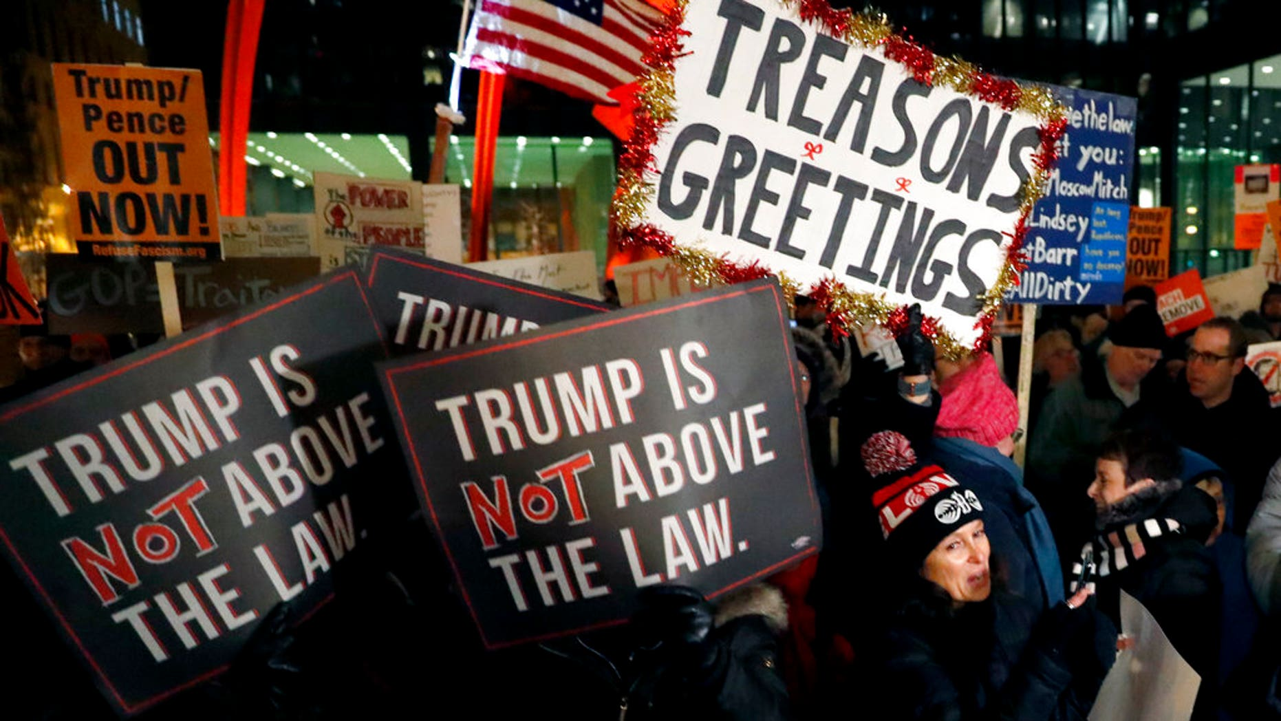 A crowd gathers on Federal Plaza for a protest against President Donald Trump on the eve of a scheduled vote by the US House of Representatives on the two articles of impeachment against the president Tuesday, Dec. 17, 2019, in Chicago. (AP Photo/Charles Rex Arbogast)