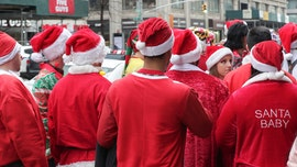 'Santas' subdue stabbing suspect on train after New York City's SantaCon
