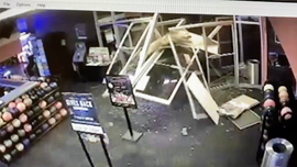 Video shows Maryland kidnapping suspect crashing into bowling alley