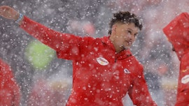 Kansas City Chiefs players get into snowball fight prior to game vs. Denver Broncos