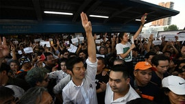 Thai protesters give three-finger 'Hunger Games' salute as thousands join largest demonstration in years