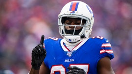 Buffalo Bills' Tre'Davious White sneaks a peak at Baltimore Ravens' play sheets blown onto field