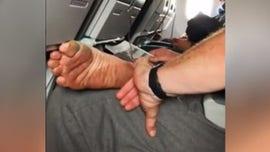 Passenger shamed for picking dead skin off of bare foot on plane: 'I'm not OK when I see this'