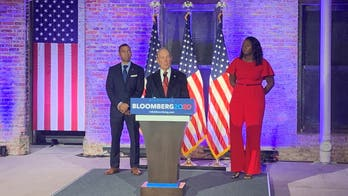 Bloomberg says he would sell company or put assets in blind trust if elected