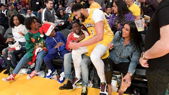 NBA star Anthony Davis fell on Kevin Hart's lap, and the jokes took off