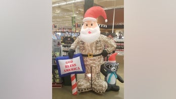Group condemns 'soldier Santa' holding 'God bless America' sign at Army base