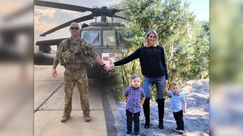 Military wife's Christmas card photo includes deployed husband