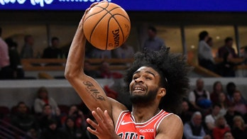 Chicago Bulls' Coby White chided for picture with Chris Paul, brother comes to his defense