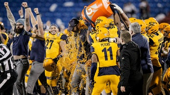 Kent State beats Utah State 51-41 for 1st bowl victory