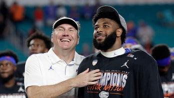 Perine leads No. 6 Gators past Virginia 36-28 in Orange Bowl