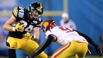 Smith-Marsette has 3 TDs, Iowa beats USC in Holiday Bowl
