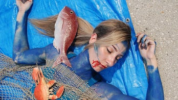 PETA activists don body paint, impersonate dead fish to protest holiday seafood sale