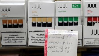 Government-funding package includes proposal to raise tobacco-buying age to 21