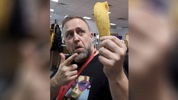 British man keeps massive potato chip in display case