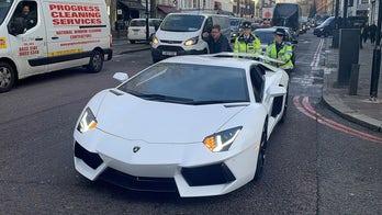 Crowd laughs as cops push busted $400,000 Lamborghini down fancy London street