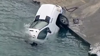 Chicago salt truck slides on icy road into Lake Michigan, workers escaped