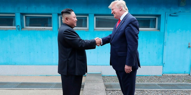 In this Sunday, June 30, 2019, photo provided by the North Korean government, North Korean leader Kim Jong Un, left, and U.S. President Donald Trump shake hands over the military demarcation line at the border village of Panmunjom in Demilitarized Zone. (Associated Press)