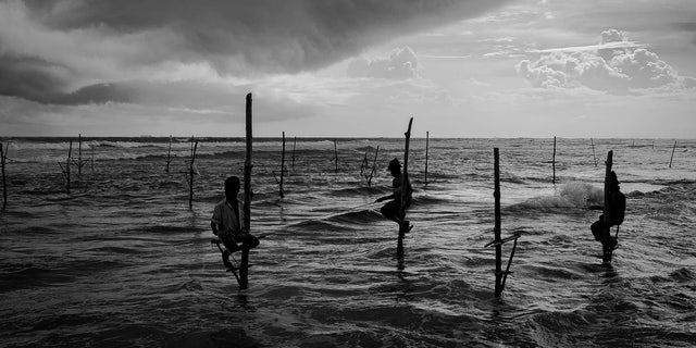 Three men recreate a non-existent way of life in water so shallow, the prospect of catching fish strains credulity.