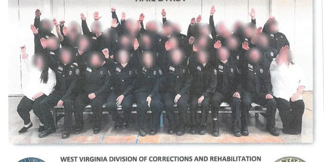 Multiple people have been either fired or suspended in connection with a photo that appeared to show corrections trainees giving a Nazi salute.