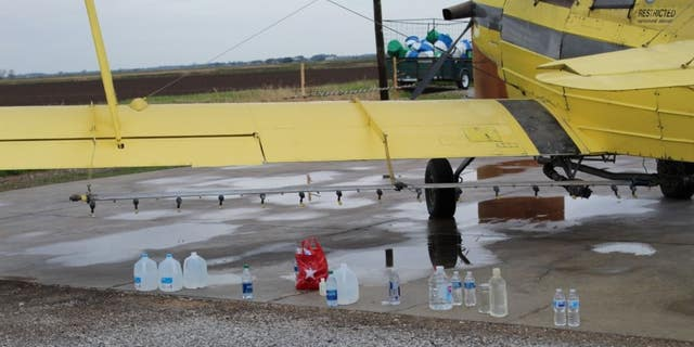 Community sprays gallons of holy water to bless town, crops