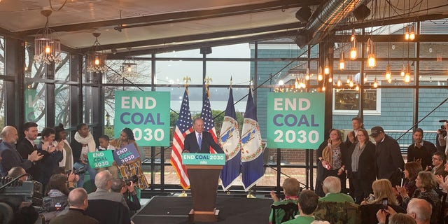 Democratic presidential candidate Mike Bloomberg unveils his plans to combat climate change at a campaign event in Alexandria, Virginia on Dec. 13, 2019